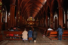 Parishioners pray in the Church of the Immaculate Conception, Manizales.