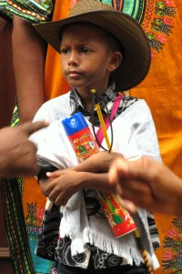 A boy holds onto a bottle of spray foam during the Cartagena Independence festivities.