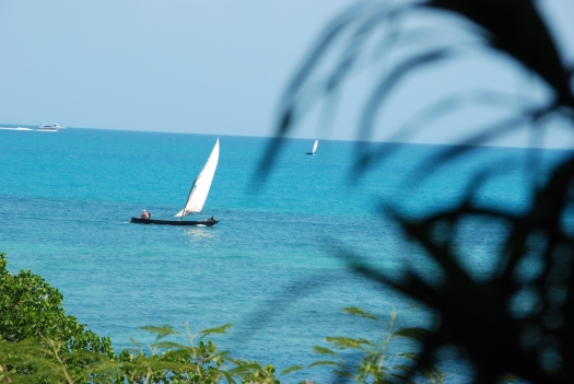 Traditional dhow fishing boat in the waters of Zanzibar.