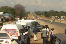 Highway with daladalas (minibuses) in western Tanzania.