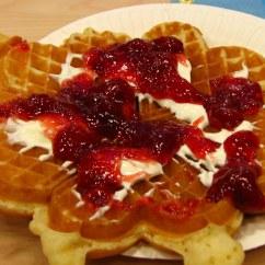 Norwegian waffle with cream and jam.