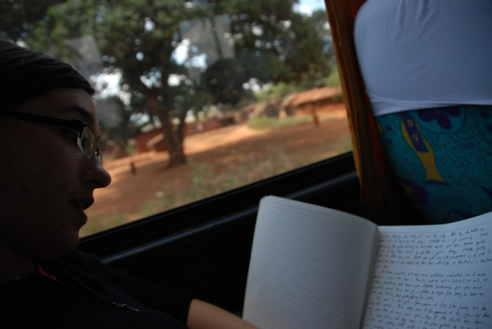 Bryanna Plog writing in her journal on a bus in northern Tanzania.