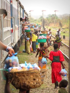 "Vendors at a train stop in central Tanzania, from ""Don't Talk to Strangers"""