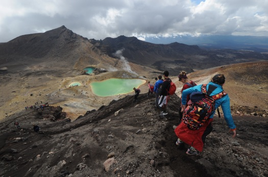 Hikers and the Emerald Lakes, Tongariro National Park, New Zealand.
