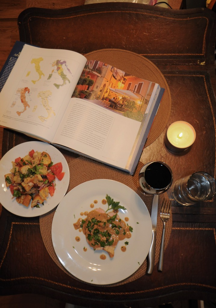 Dinner of pork, panzanella, wine, and the book.