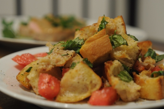 Bread salad (panzanella), made with bread, tomatoes, shallots, basil, olive oil, and red wine vinegar.